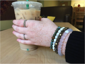 Kerry Meehan '17 shows off her stacked bracelets and rings.