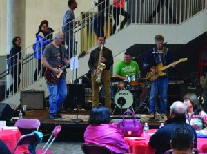"A band made up of alumni, ""The Adults,"" performed in the Lower Level of the Barone Campus Center, after the originally scheduled performance near the Stag statue was changed due to rain."