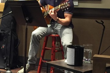Senior Tom Wohlmacher plays his guitar for an audience. Contributed Photo
